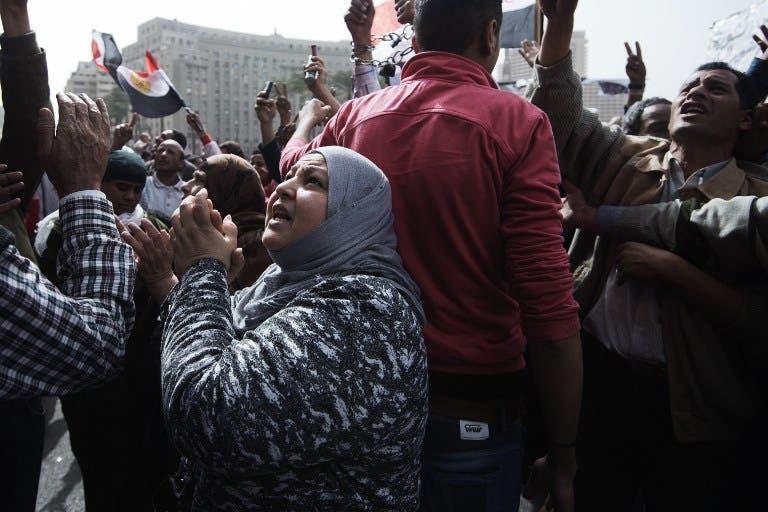 Egyptian women shout slogans against President Mohamed Morsi's government at Tahrir square. (AFP PHOTO/GIANLUIGI GUERCIA)