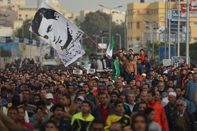Egyptians attend the funeral procession of Abdelhalim Mehana, who was killed during clashes with riot police in Port Said on March 4. AFP PHOTO / KHALED DESOUKI