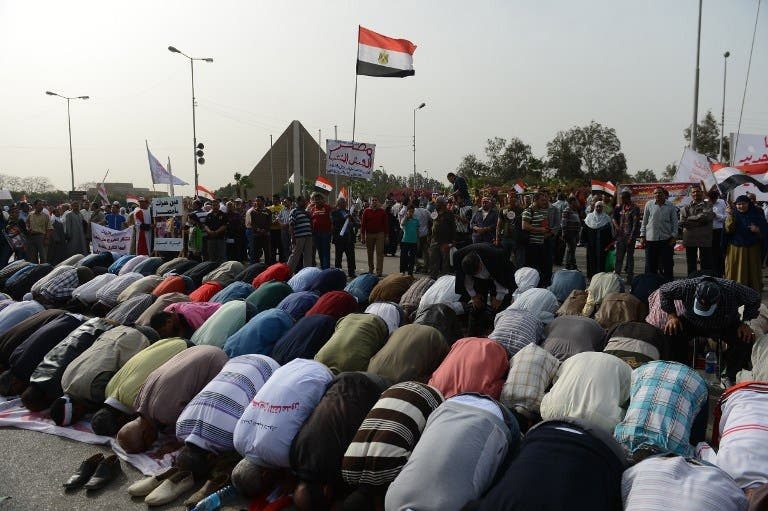 Egyptian protestors pray during a demonstration to show their support for their country's military and against the ruling Muslim Brotherhood, on March 15 in Cairo. (AFP PHOTO / KHALED DESOUKI)