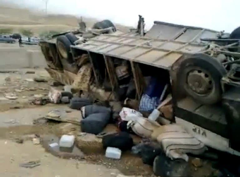An image grab taken from a video uploaded on YouTube on March 16, 2013 shows a bus following an accident with a truck in the Adssiyeh region in southwest Jordan. (AFP PHOTO/YOUTUBE)