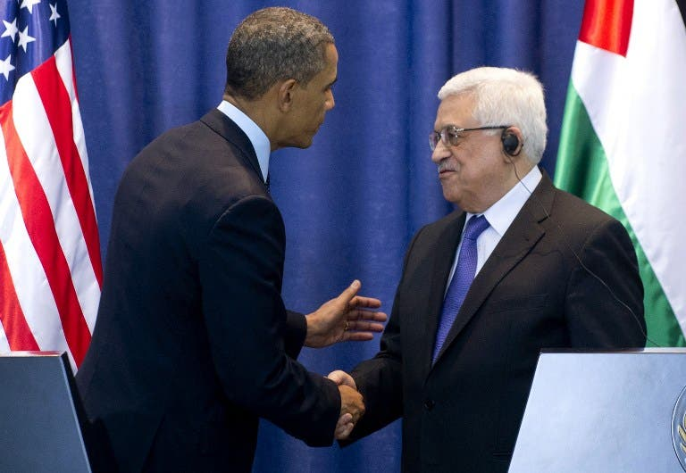 Palestinian president Mahmoud Abbas (R) and U.S. President Barack Obama shake hands following a joint press conference at the Muqata, the Palestinian Authority headquarters, in the West Bank city of Ramallah on Thursday. (AFP PHOTO/SAUL LOEB)