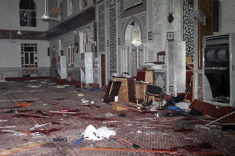 An image made available by the Syrian Arab News Agency (SANA), shows remains and the carpeted floor covered with blood inside of the Iman Mosque in the Mazraa neighborhood of the Syrian capital Damascus. (AFP PHOTO /HO-SANA)