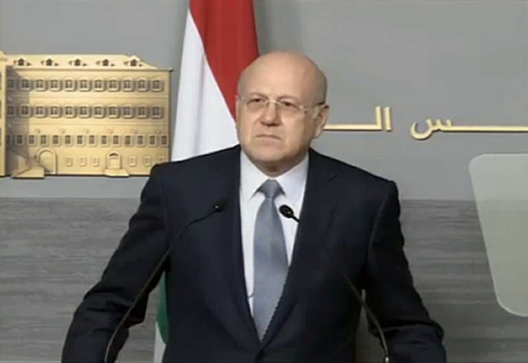 An image grab taken from the Lebanese Broadcasting Corporation (LBC) news channel on March 22, 2013 shows Lebanese Prime Minister Najib Mikati announcing the resignation of the Lebanese government during a press conference in Beirut. (AFP PHOTO/LBC)