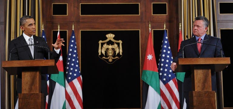 US President Barack Obama (L) speaks near Jordan's King Abdullah II during a joint press conference following a meeting at Al-Hummar Palace in Amman on March 22, 2013. Obama arrived in Jordan to face scrutiny over his Syria strategy, on the last leg of a Middle East tour after visits to Israel and the Palestinian territories. (AFP PHOTO/MANDEL NGAN)