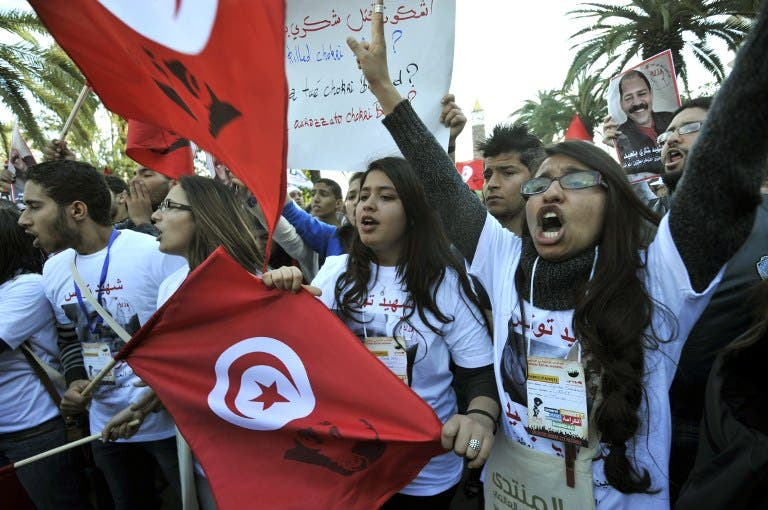 Tunisian women shout slogans during a demostration in the center of Tunis after the opening of the World Social Forum (WSF) on March 26, 2013. More than two years after the Jasmine revolution, tens of thousands of people are expected for the WSF, dubbed the forum of