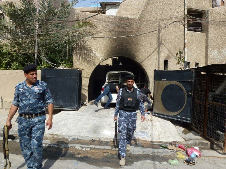 Iraqi policemen inspect the premisses of the al-Mustaqbal (The Future) newspaper in the Karrada district of Baghdad on April 2, 2013, following an attack. (AFP PHOTO/SABAH ARAR)