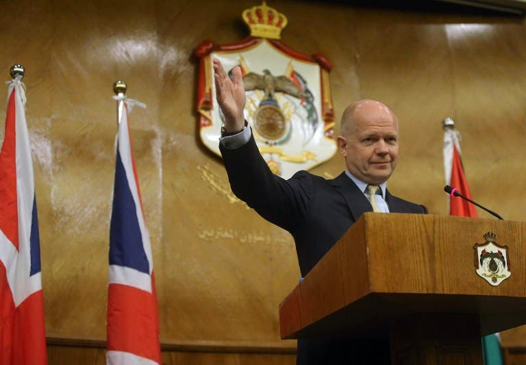 British Foreign Secretary William Hague waves during a press conference in Amman on May 22 (AFP)