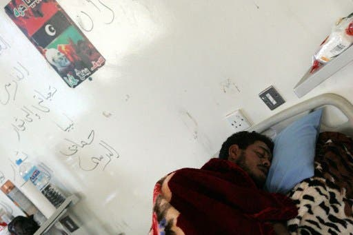 A Libyan soldier wounded from overnight clashes rests in his hospital bed on Saturday in Benghazi. AFP image