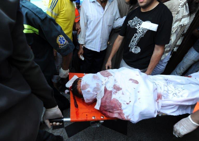 A slain Muslim Brotherhood protester is carried away in Cairo on July 27. AFP / FAYEZ NURELDINE