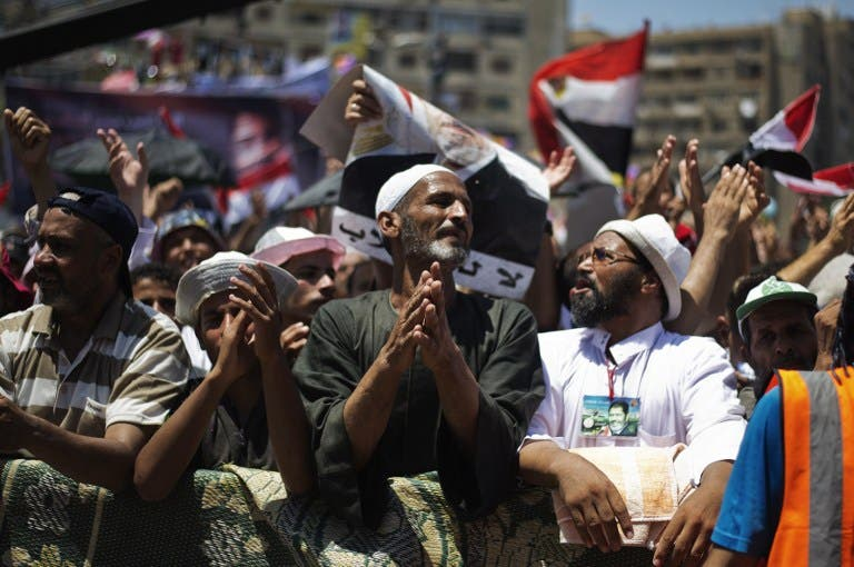 EGYPT, Cairo : Members of the Muslim brotherhood and supporters of ousted Egyptian President Mohammed Morsi attend a sit-in outside the Rabaa al-Adawiya mosque on the first day of Eid al-Fitr celebrations on August 8, 2013 in Cairo. (AFP)