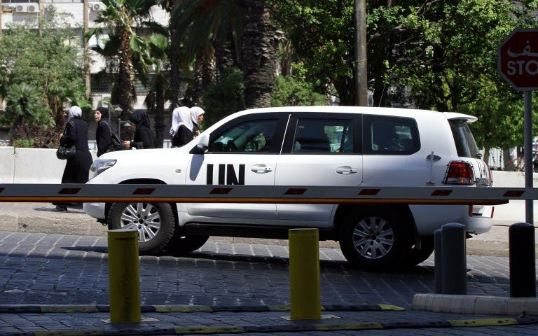 The UN chemical weapons investigation team arrives in Damascus on August 18, 2013. (AFP)