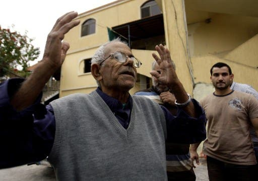 The family of Mohammed Adnan, a suspect in the bombing of the Iranian embassy in Beirut, have disavowed the alleged suicide bomber along with the Palestinian leadership. Here, his grandfather reacts in front of the building where his family lives (AFP)