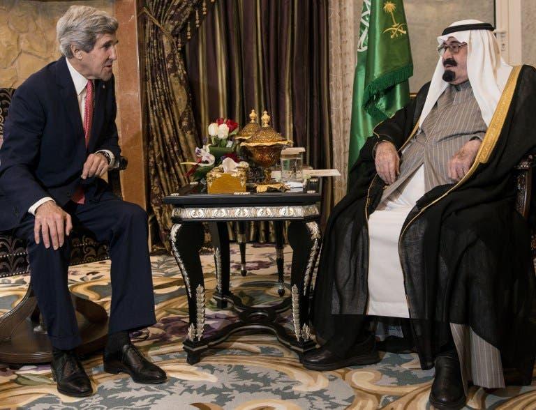 US Secretary of State John Kerry and Saudi Arabia's King Abdullah bin Abdulaziz al-Saud talk before a meeting at the King's desert encampment on January 5, 2014 [AFP]