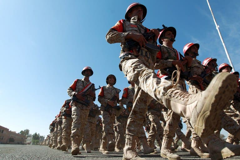 Yemeni Military Police march during a ceremony launching the first phase of combat and operations training of the year on January 8, 2014 in the Yemeni capital Sanaa. [AFP]