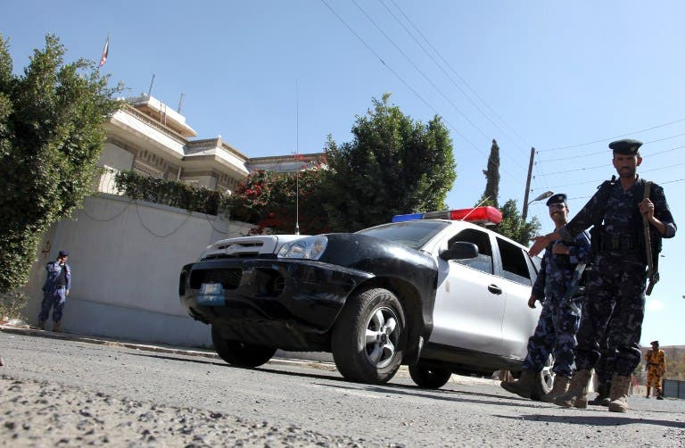 Guards on watch after an unknown assailant killed an Iranian diplomat in a drive-by shooting outside the ambassador's residence in the Yemeni capital. [AFP]