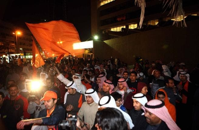 Kuwaiti opposition supporters demonstrate in downtown Kuwait City late on Saturday night, to demand dissolution of the new parliament. (AFP PHOTO/YASSER AL-ZAYYAT)