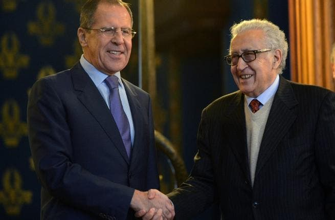 Russian Foreign Minister Sergei Lavrov (L) shakes hands with UN-Arab League peace envoy Lakhdar Brahimi as they arrive for talks in Moscow, on Saturday. (AFP PHOTO / KIRILL KUDRYAVTSEV)