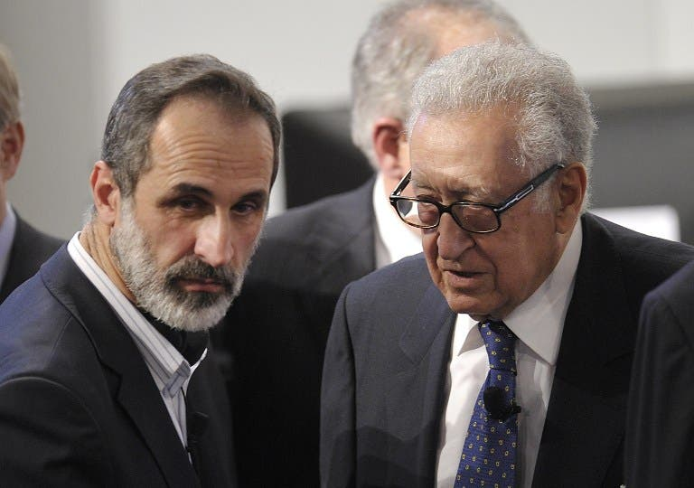 Lakhdar Brahimi (R), Joint Special Representative of the United Nations and the League of Arab States on Syria, talks with Sheikh Moaz Al-Khatib, head of the Syrian oposition during the Munich Security Conference. (AFP PHOTO / THOMAS KIENZLE)