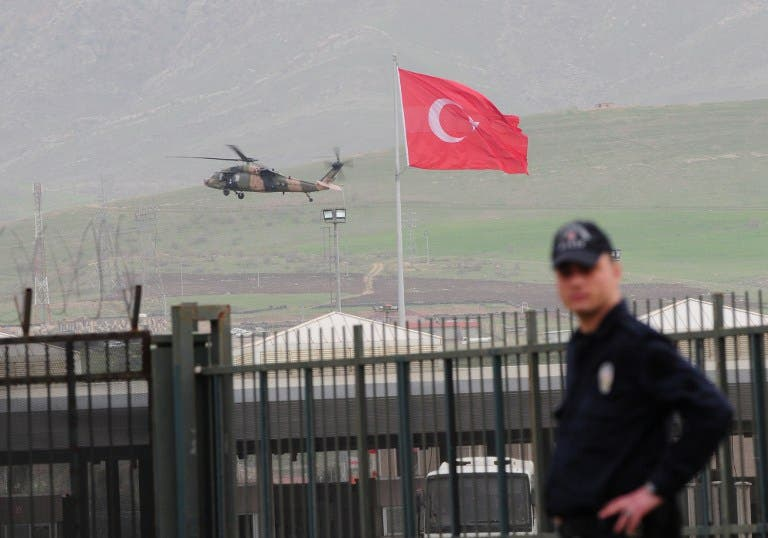 A helicopter of the Turkish army brings back Turkish prisoners over the Habur border crossing, in Sirnak, on the Turkish side, on Wednesday after they were released by the Kurdish Workers' Party (PKK). (AFP PHOTO / STR)