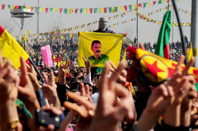 Kurds celebrate on March 21, 2013 Nowruz, the Persian New Year festival, and flash victory signs in the southern Turkish city of Diyarbakir. (AFP)