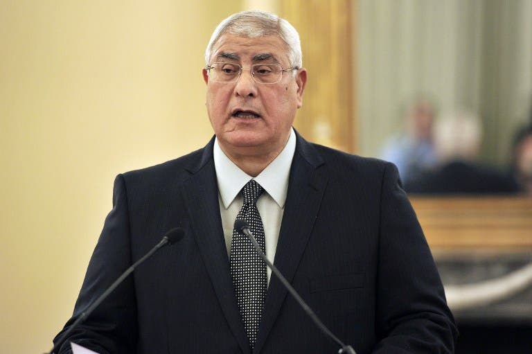 Interim President of Egypt, Adly Mansour, makes statements to the press. [AFP]