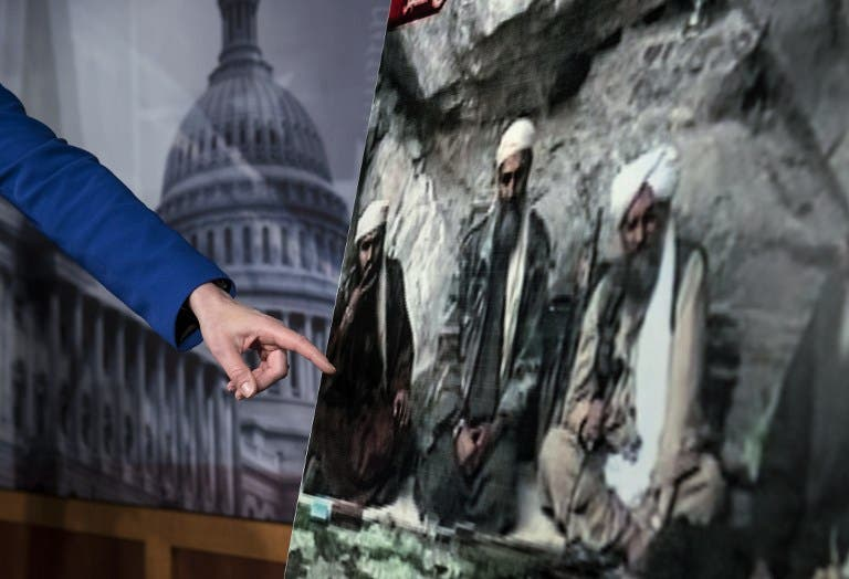 US Senator Kelly Ayotte points to a photo of Sulaiman Abu Ghaith (L) during a press conference on Capitol Hill in Washington, DC. (AFP PHOTO/Brendan SMIALOWSKI)