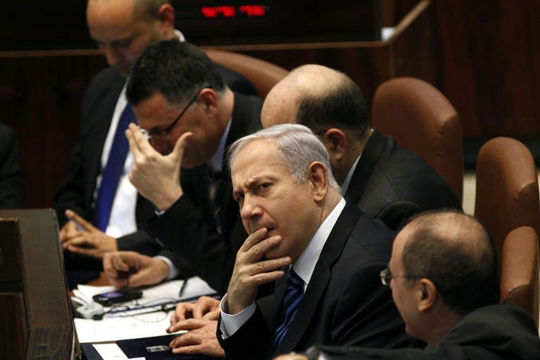 Israeli Prime Minister Benjamin Netanyahu (C) attends a special Knesset (Israeli parliament) session in Jerusalem. (TOPSHOTS/AFP PHOTO/GALI TIBBON)
