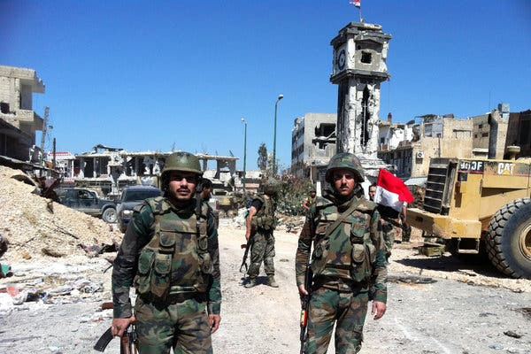 Hezbollah fighters assisted regime forces in seizing the Lebanese border town al-Qusayr from rebel forces earlier this year (AFP/Getty Images)