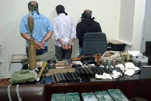 In this picture released by the State Security on Friday, Sept. 20, 2013, blindfolded suspects stand near seized weapons and explosives. (The Daily Star/NNA, HO)