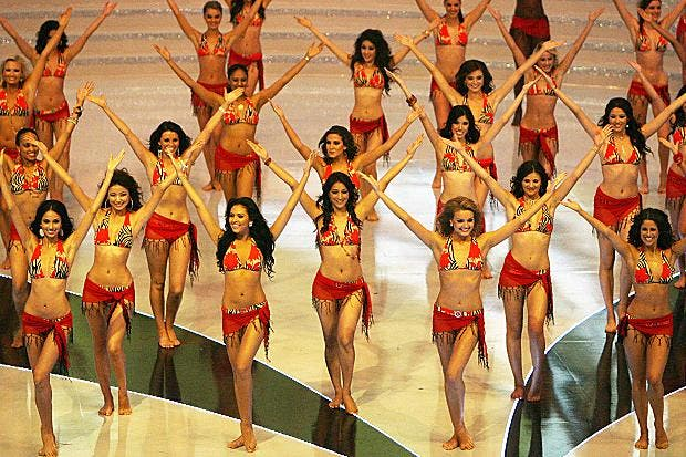Miss World contestants dance in swimsuits in the Chinese city of Sanya in 2012. [Mark Ralston/AFP/Getty Images]