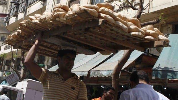 Street vendor distributing bread in Egypt