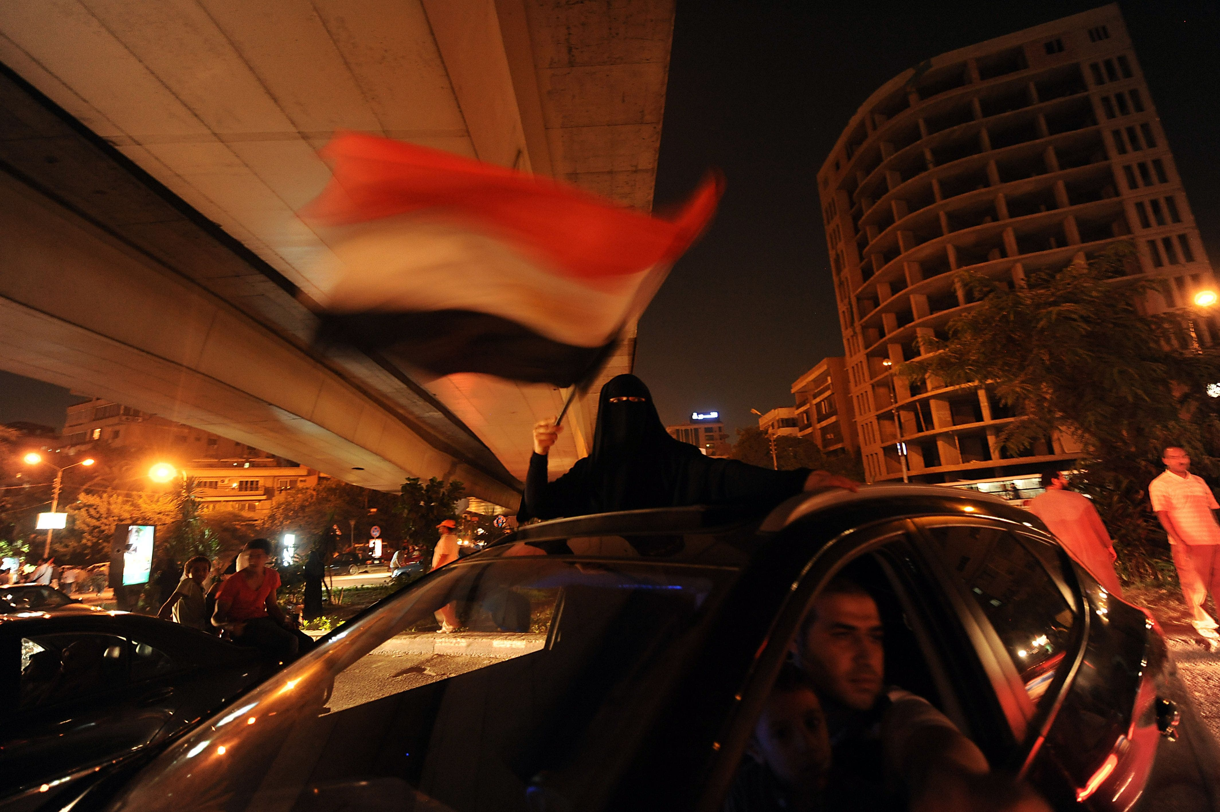 An Egyptian female supporter of the deposed president Mohamed Morsi waves a national flag during a demonstration against the government in Cairo on July 31, 2013. (AFP)