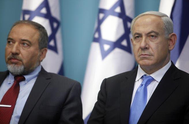 Avigdor Lieberman (L) with Israeli prime minister, Binyamin Netanyahu (R)