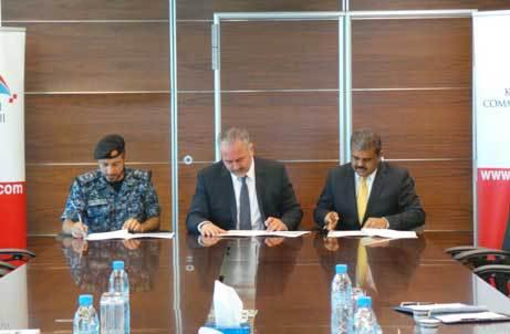 Colonel Sameer Jassim Showaiter, Mr. Mohamed Ahmed Mohamed Yateem and Mr. Silvan Varghese during the signing.