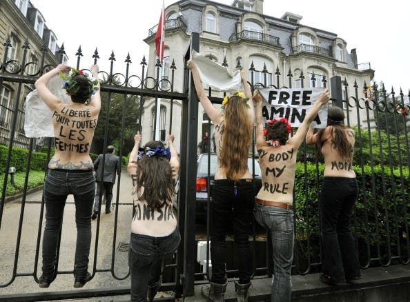 FEMEN activists protest outside the Tunisian embassy in Brussels on Thursday after three of their  bare-breasted companions get jailed in Tunis.