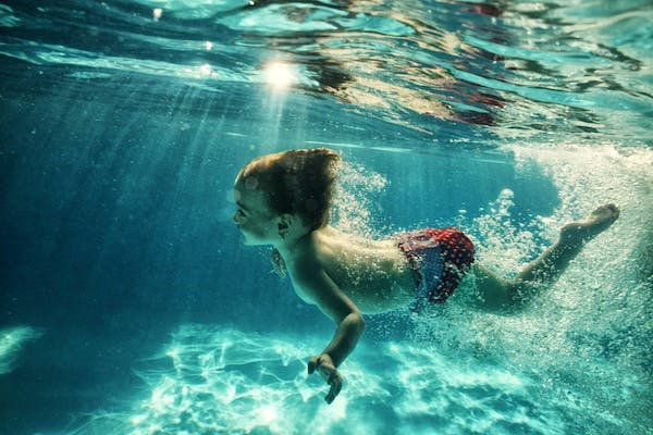 A Dubai court has posthumously blamed a nine-year-old boy for drowning at a pool party. (Shutterstock)