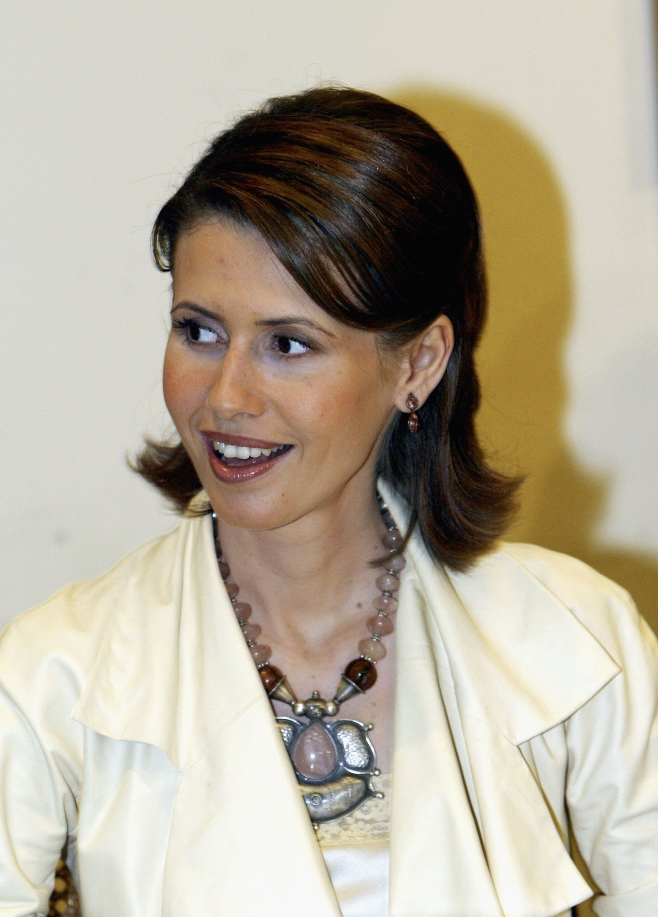 """President Bashar Al-Assad Wife, Asma: """"the freshest and most magnetic of first ladies."""" with her simple chic style."""