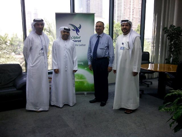 Abdulrahman Al Ali welcoming the National Air Cargo team in his office with Salem Bin Suloom