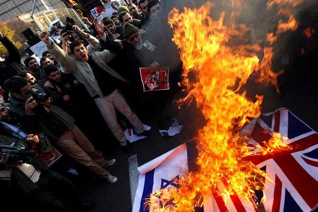 Angry protestors in Tehran stormed the British embassy two years ago causing the two countries to sever ties (Getty)