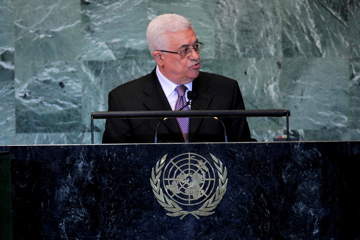Mahmoud Abbas, President of the Palestinian National Authority (PNA), receives a standing ovation at the UN after giving his speech for statehood.