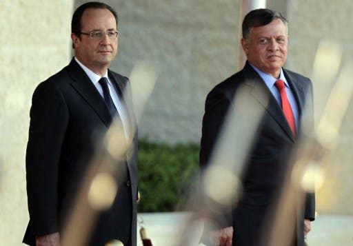 Jordan's King Abdullah and French President Francois Hollande at Al-Hummer Royal Offices in Amman on Sunday. (AFP)