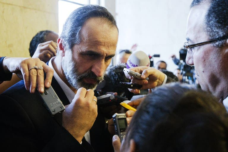 The Syrian opposition's National Coalition chief Ahmed Moaz al-Khatib speaks to the press after a meeting at the Egyptian foreign ministry in Cairo.