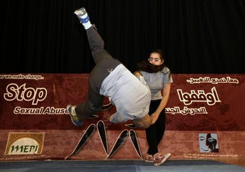 A girl demonstratesher newly acquired Aikido skills