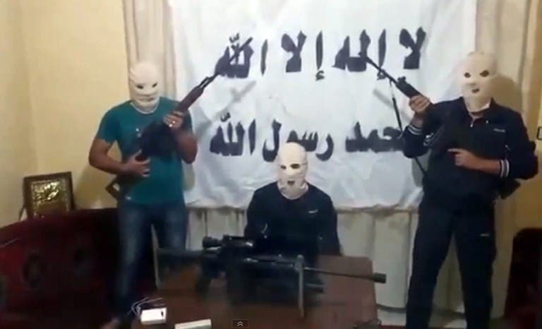 A screengrab taken from a video released on You Tube on August 15, 2013 allegedly shows three armed and masked members of a previously unknown Syrian rebel group that claimed responsibility for the blast in the Lebanese capital Beirut. (AFP/YouTube)
