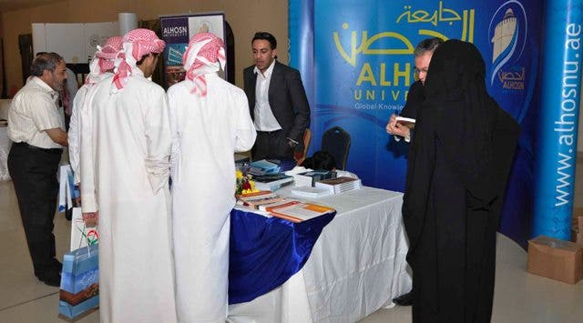 ALHOSN University's booth at Al Gharbia Universities and Colleges Fair