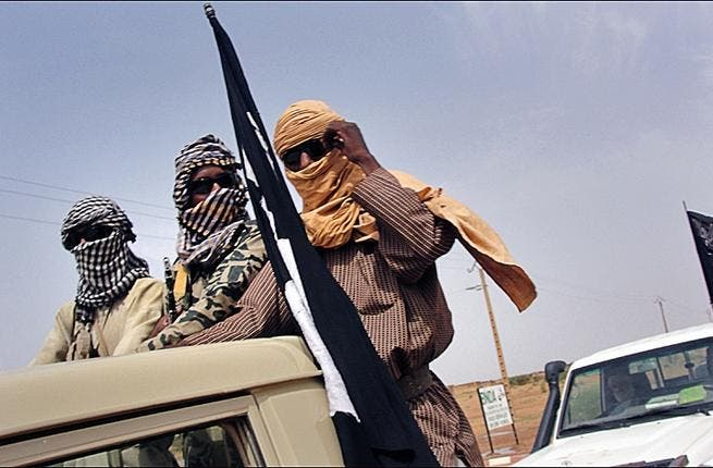 Fighters from al-Qaeda splinter group MUJAO watch Gao airport on August 7th. Al-Qaeda central is reportedly shifting operations from Afghanistan to North Africa. (AFP/Romaric Ollo Hien)