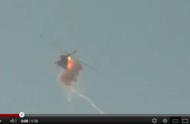 Screenshot from the video appearing to show a helicopter shot down in Aleppo