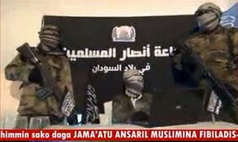 Members of the Ansaru group speaking in an unverified location on Dec 24 2012 (AFP Photo)