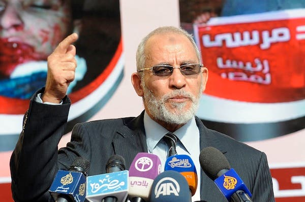 Three judges in the trial of Muslim Brotherhood supreme guide Mohammed Badie withdrew from the session on Tuesday. (AFP/File)