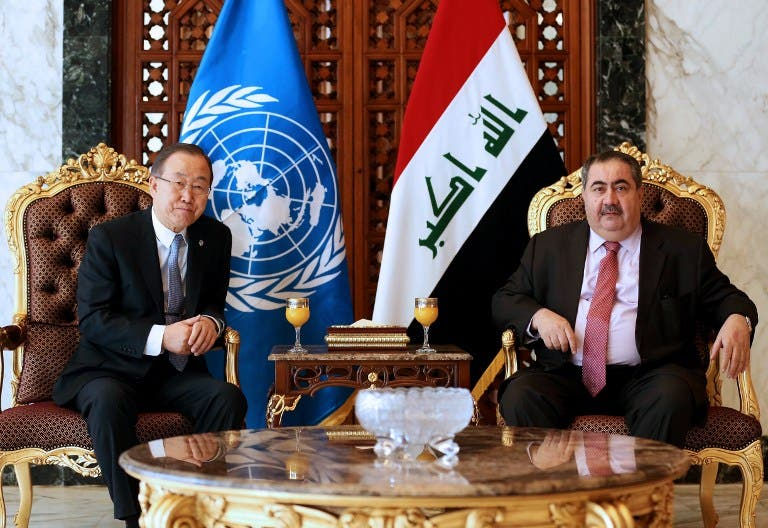 Iraqi Foreign Minister Hoshyar Zebari (R) greets United Nations Secretary-General Ban Ki-moon at Baghdad airport on January 13, 2014, upon the latter's arrival for a two-day visit to Iraq. (AFP)